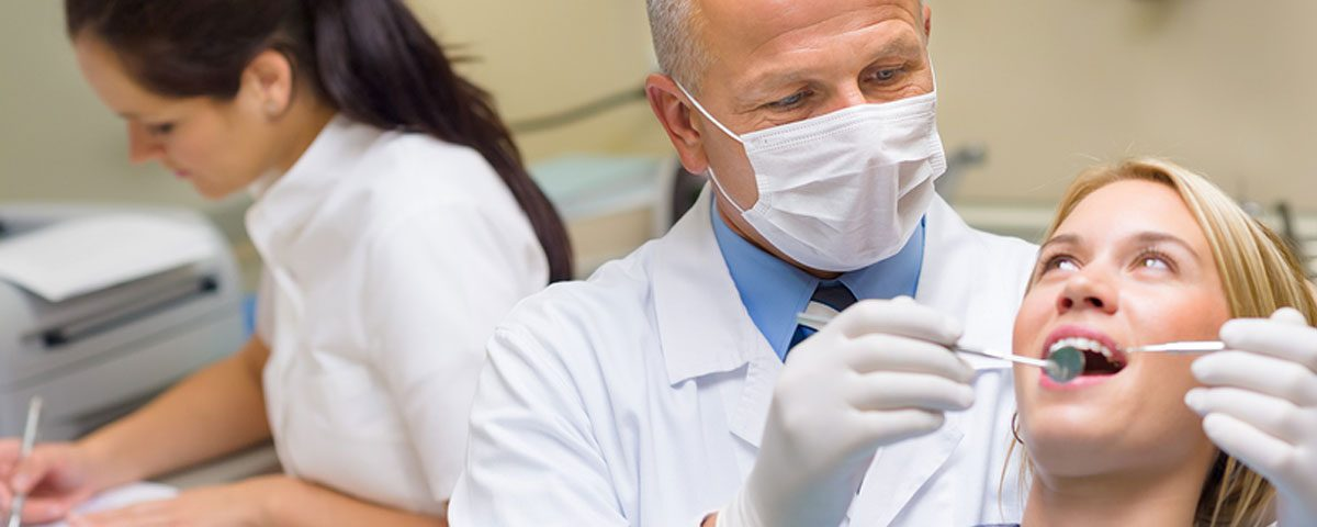 Dentist with patient, Dental Bridge Selection