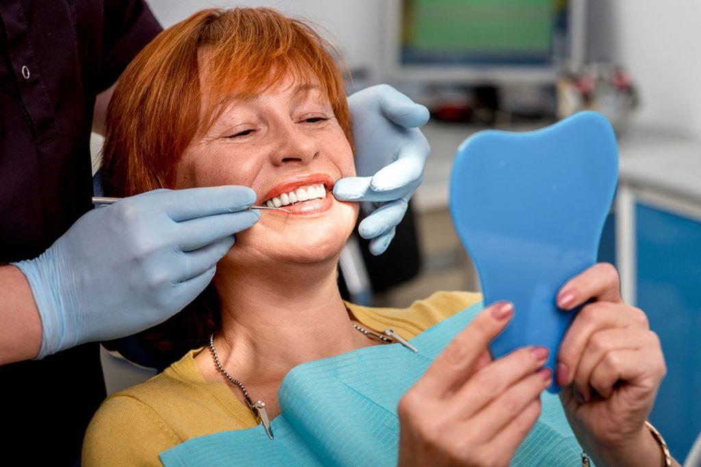 Old woman with dentist, Dental Veneer or Implants